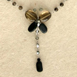 Quartz and ceramic pendant necklace, 'Black Flutters'