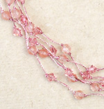 Rose quartz and rayon necklace, 'Pink Waterfall'