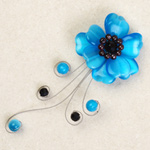 Garnet and glass flower brooch, 'Blue Glory'