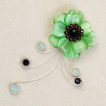 Garnet and glass flower brooch, 'Green Glory'