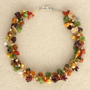 Peridot and garnet cluster necklace, 'Siamese Garland'