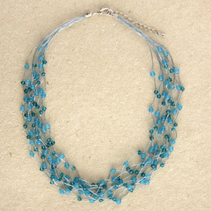 Glass and rayon necklace, 'Blue Waterfall'