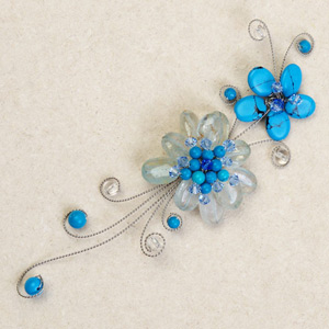 Dyed topaz flower brooch, 'Blue Tendrils'
