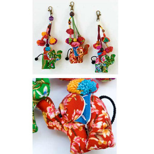 Cotton and wood ornaments, 'Lisu Elephants Festival' (set of 3)