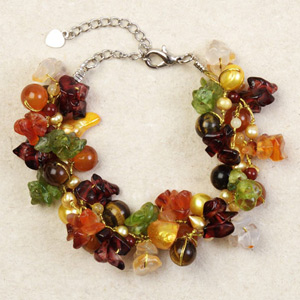 Peridot and garnet cluster bracelet, 'Siamese Garland'