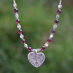 Silver and garnet necklace, 'Love Luck'
